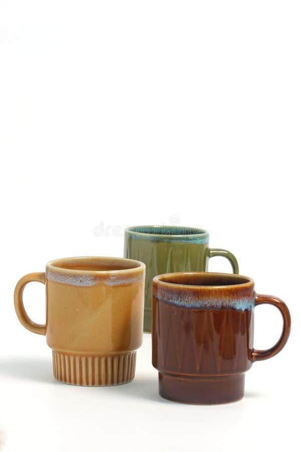 Tazze di caffè sopra la b bianca fotografia stock libera da diritti