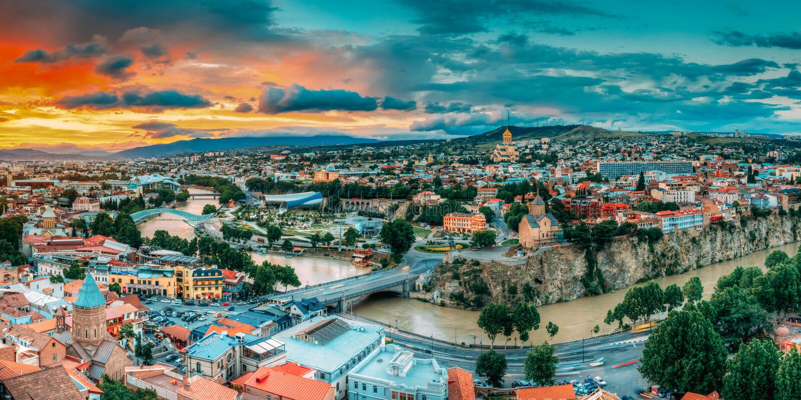 Tbilisi, Georgia. Panorama Cityscape Of Summer Old Town. Metekhi Church. Of Assumption In Historic Neighborhood Of Tbilisi During Beautiful Sunrise. Central stock photography