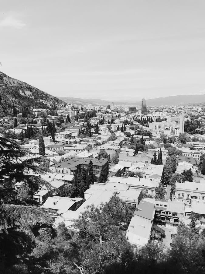 Tbilisi landscape Georgia. Monochrome photo of Tbilisi. Landscape photo of Tbilisi houses, modern architecture, old City and river Kura royalty free stock image