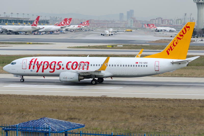 TC-IZC Pegasus Airlines,Boeing 737-86J. TC-IZC is rolling for take-off on runway 35L at Istanbul Ataturk Airport LTBA, February 27, 2015 royalty free stock images