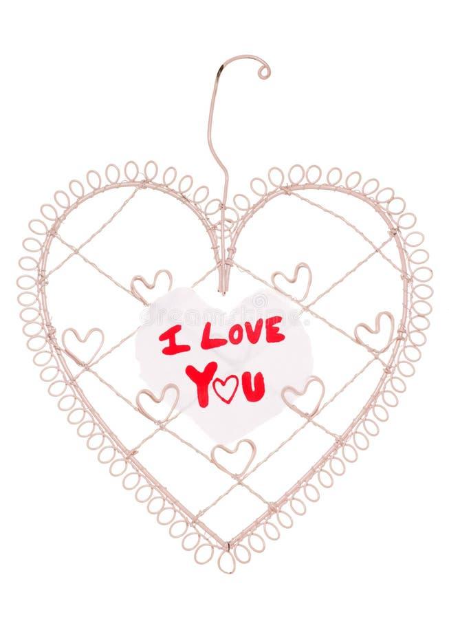 Te amo mensaje en una tarjeta de la nota del corazón imágenes de archivo libres de regalías