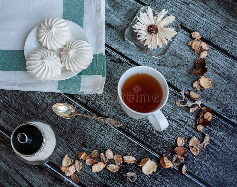 Te och maräng royaltyfria foton