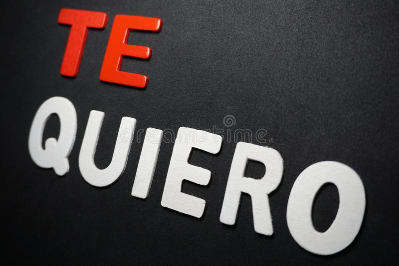 Te quiero. Text color letter style typography calligraphy creative design fonts type red white on black back background wallpaper concept identity stock image