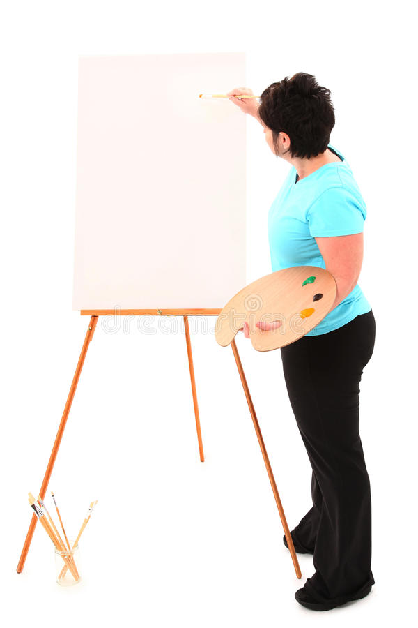 Te zware Vrouw bij het Schilderen van de Schildersezel stock afbeelding