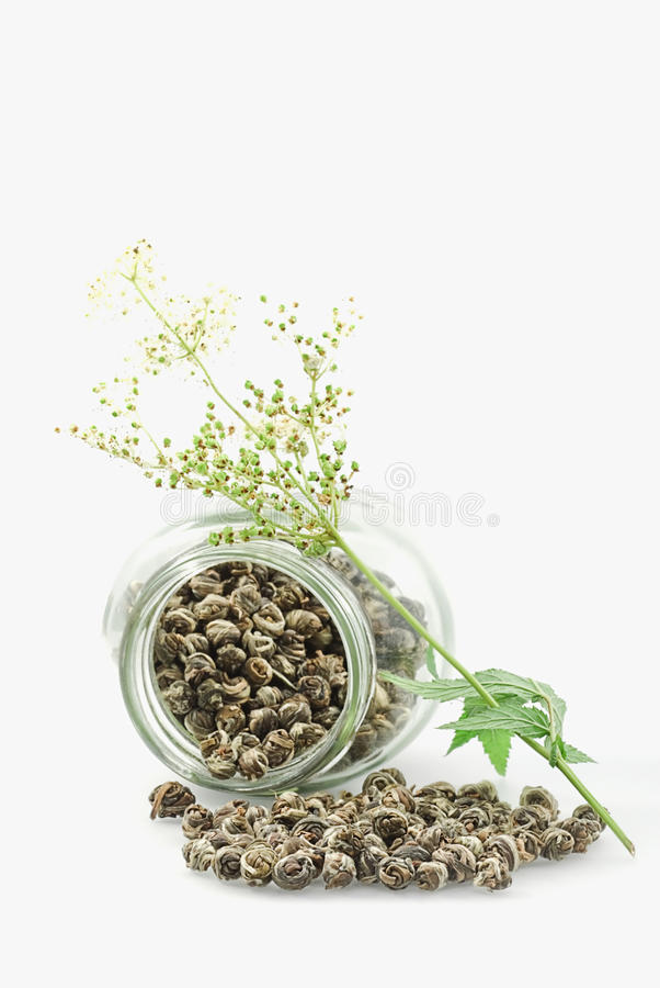 Tea. Glass bank- flower and herbal tea royalty free stock image