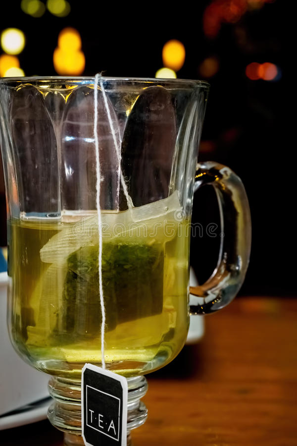 Tea bag in a cup stock photo