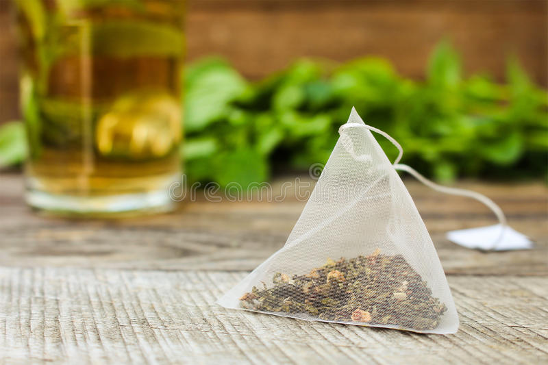 Tea bag, mint, cup of tea royalty free stock photos