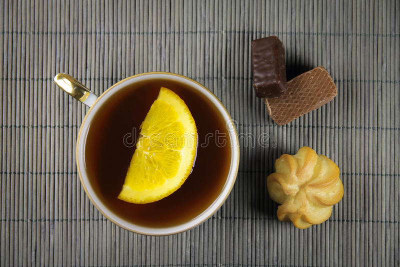 Tea on the bamboo background. Tea with orange on the bamboo background royalty free stock photography