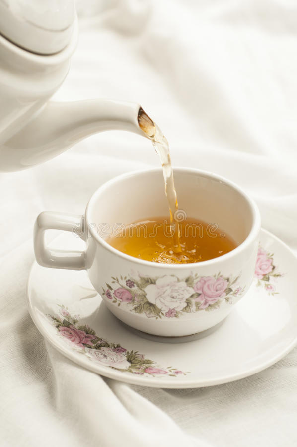 Download Tea Being Poured Into Tea Cup Stock Image - Image: 27311493