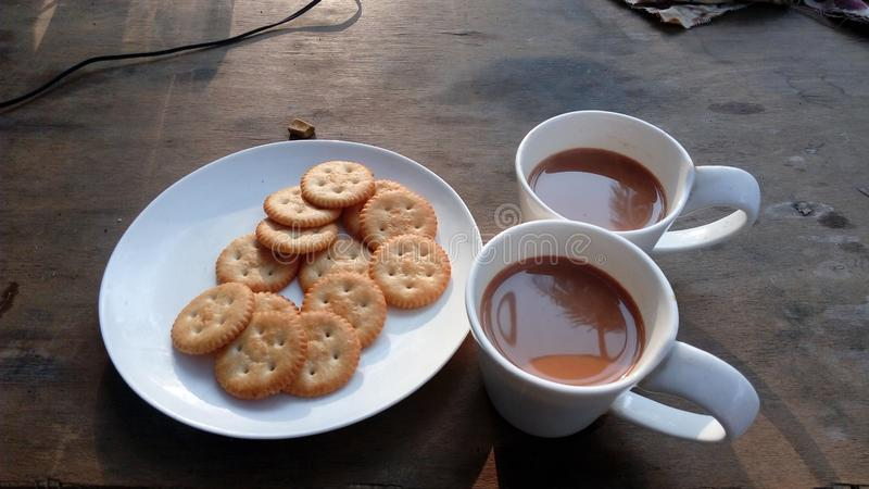 Tea with biscuits on table stock image