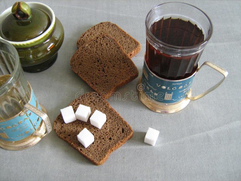 Tea, black bread and sugar royalty free stock image