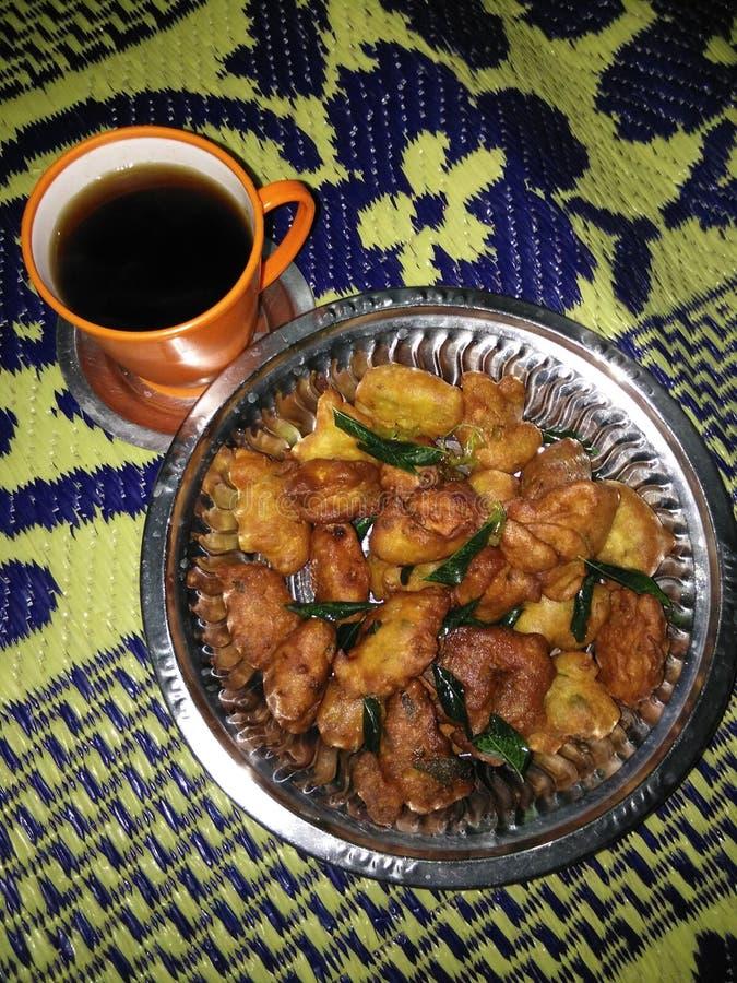 Tea with bonda stock photos