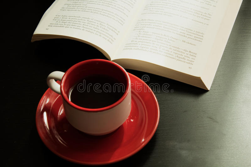 Tea and book stock photos