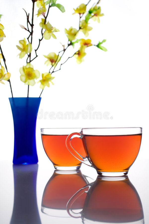 Tea break. Two cups of tea in the light royalty free stock images