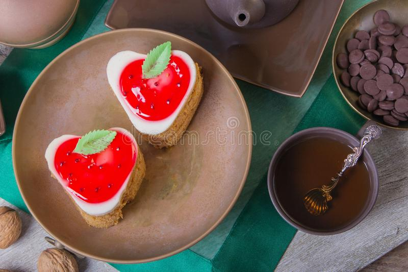 Tea break with a delicious strawberry cake and small chocolates. Copper and clay plates in a composition with jugs. Arab concept.  royalty free stock photos