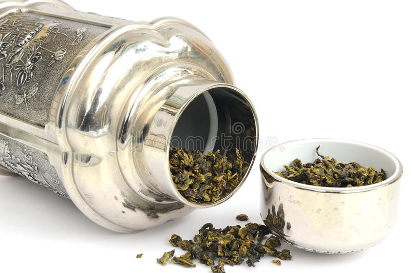 Tea caddy. With TieGuanyin on the white background royalty free stock images