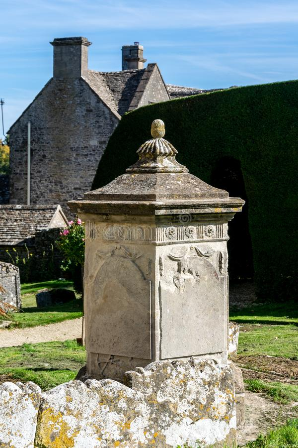 Tea caddy style tomb, St Andrew, Miserden, Gloucestershire. Tea caddy style tomb, churchyard of St Andrew, Miserden, Gloucestershire royalty free stock photos