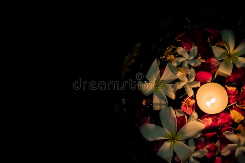 Tea candles and flowers floating on water. Diwali stock images