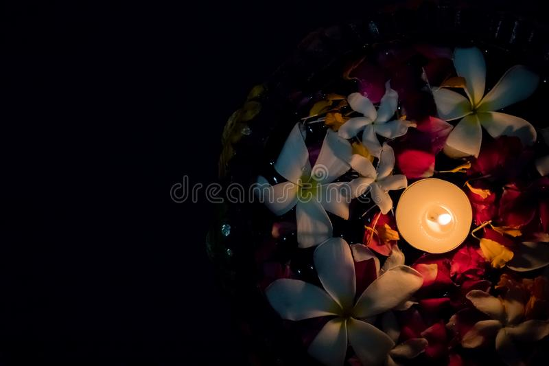 Tea candles and flowers floating on water. Diwali in india royalty free stock images