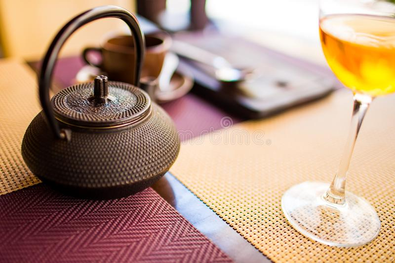 Tea ceremony concept. Tea pot on table in cafe close up. Holiday time, travelling abroad. Tea ceremony concept. Tea pot on table in cafe close-up. Holiday time stock photos
