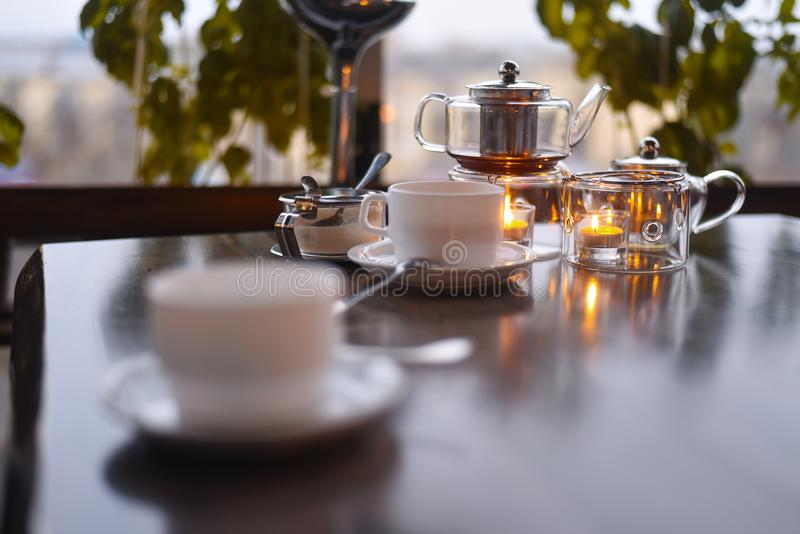 Tea ceremony in the cafe. Tea ceremony in the dining candlelight stock photo