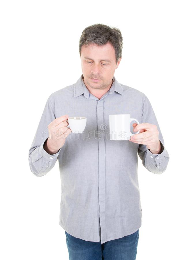 Tea and coffee addiction man looking cup and mug hot drink stock image