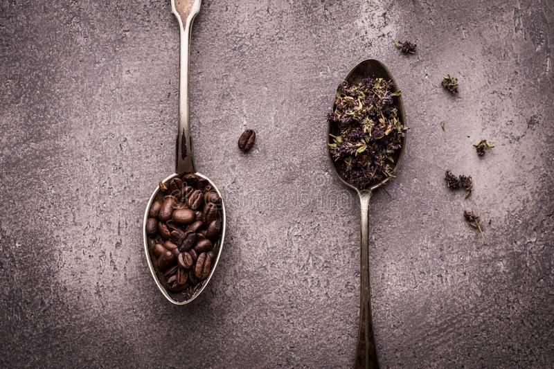Tea and Coffee Beans in Rustic Spoons royalty free stock photography