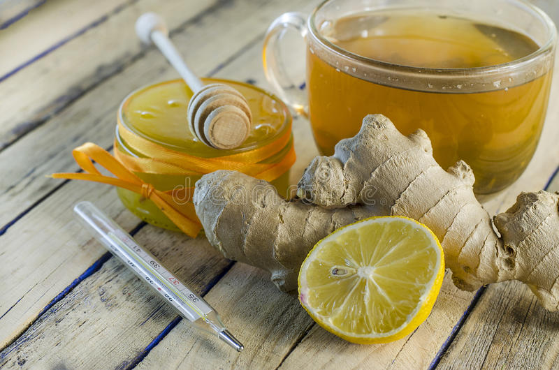 Tea for colds. With ginger and lemon and honey stock image