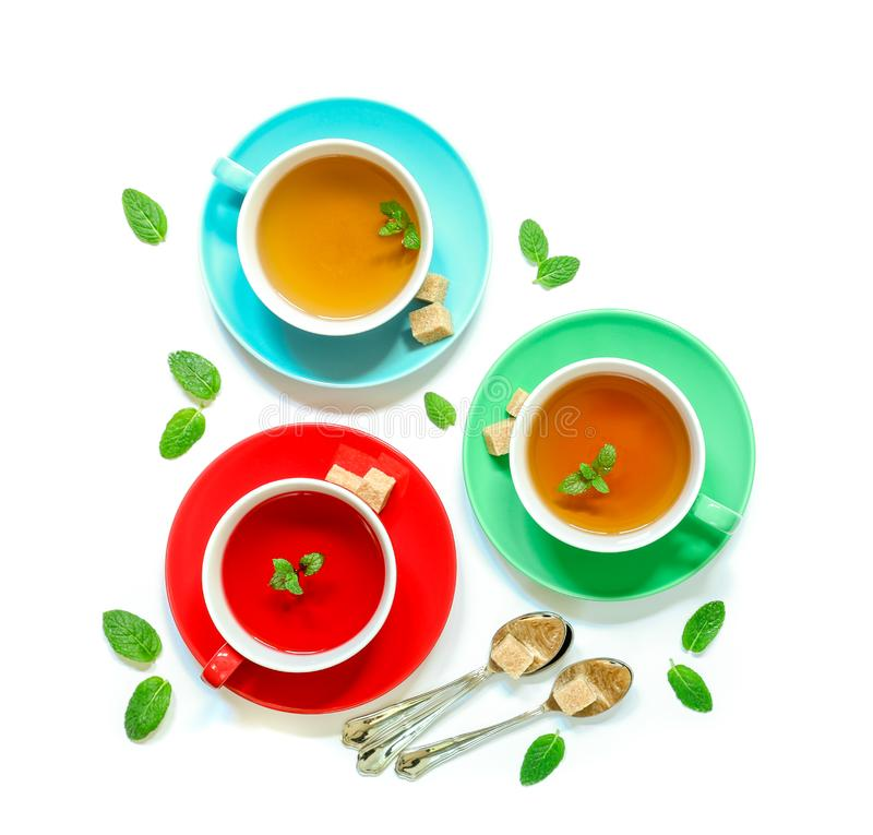 Tea Collection of three different types of tea - mint, hibiscus and herbal tea in cups isolated on white. stock photos