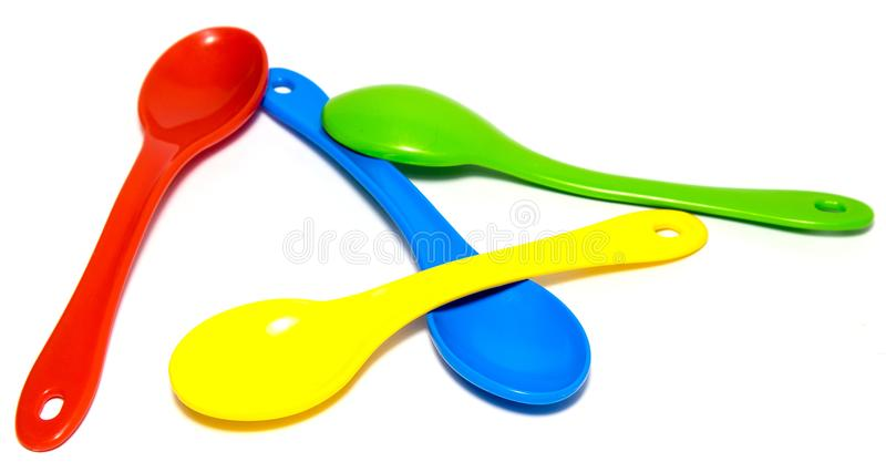 Tea Colored Spoons, Isolated royalty free stock photo