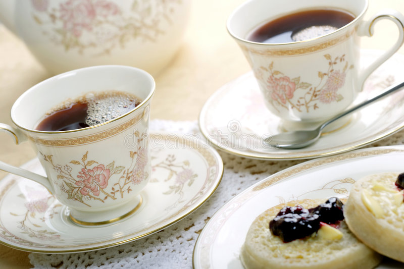 Tea and crumpets royalty free stock images