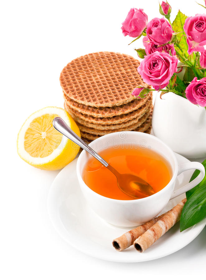 Download Tea In Cup With Biscuits And Lemon Stock Photo - Image of pastry, roses: 23400706