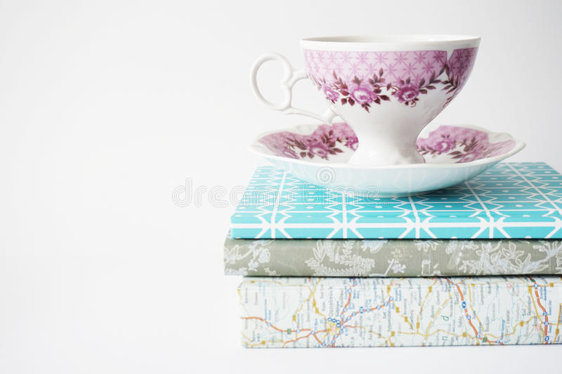 Tea cup on books royalty free stock image
