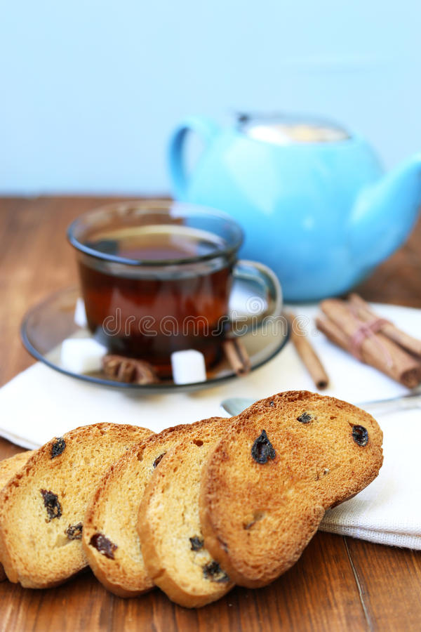 Tea in cup. Fresh tea in transparent cup,with rusks on wooden background stock photography