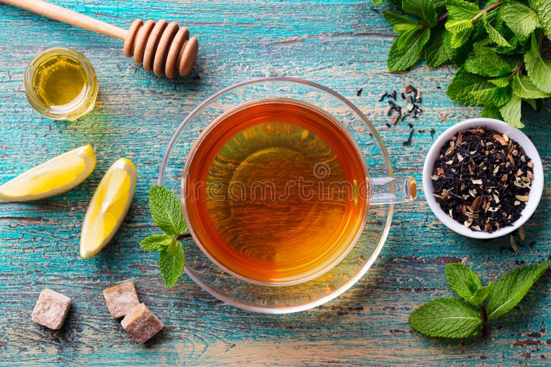 Tea cup with mint leaf and honey. Wooden background. Top view. Tea cup with mint leaf and honey. Wooden background. Top view royalty free stock photo