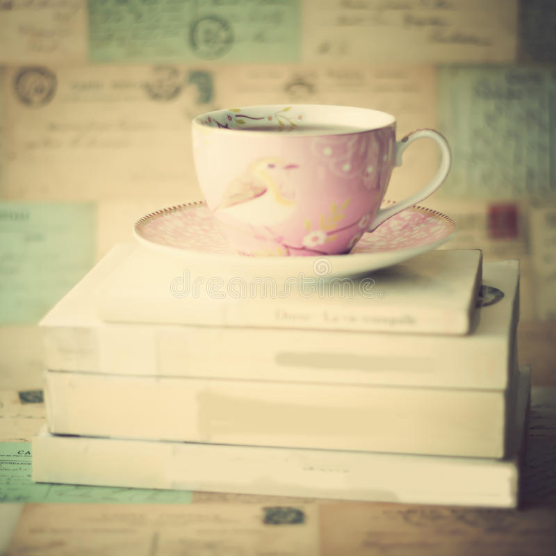 Tea cup over books. Vintage tea cup over books royalty free stock photography