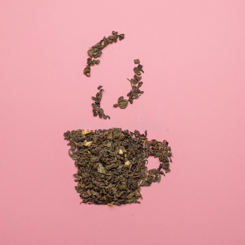 Tea cup-pictogram gemaakt van droog Oolong-theeblad royalty-vrije stock foto's