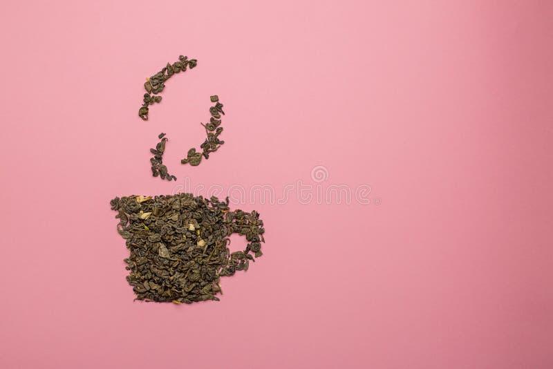 Tea cup-pictogram gemaakt van droog Oolong-theeblad royalty-vrije stock foto