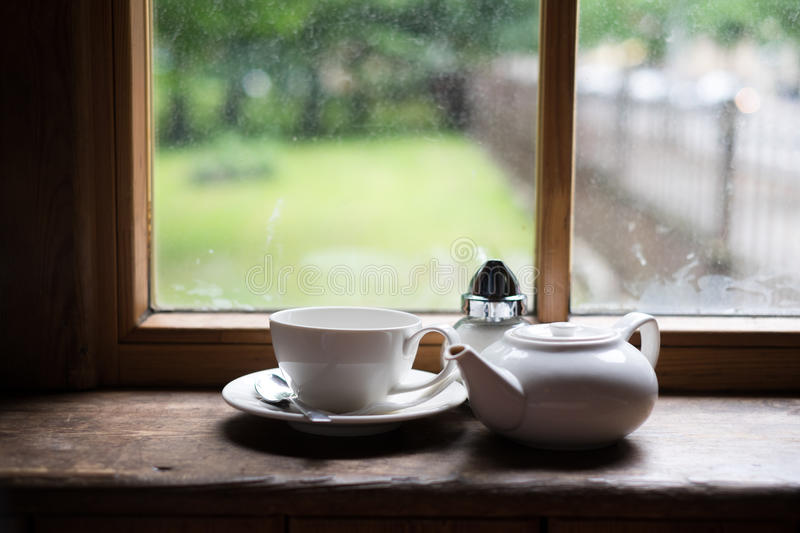 Tea cup pot and sugar on wood table stock image