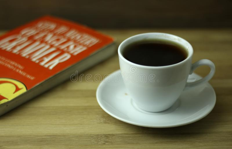 Tea cup with red book royalty free stock photography