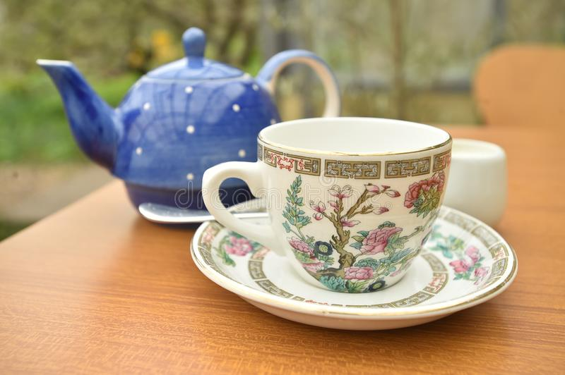 Teapot and cup of tea together on a table royalty free stock photography