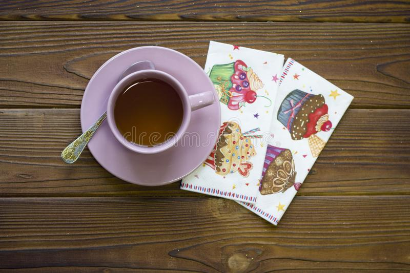 Tea cup with spoon and decorated napkins royalty free stock photo