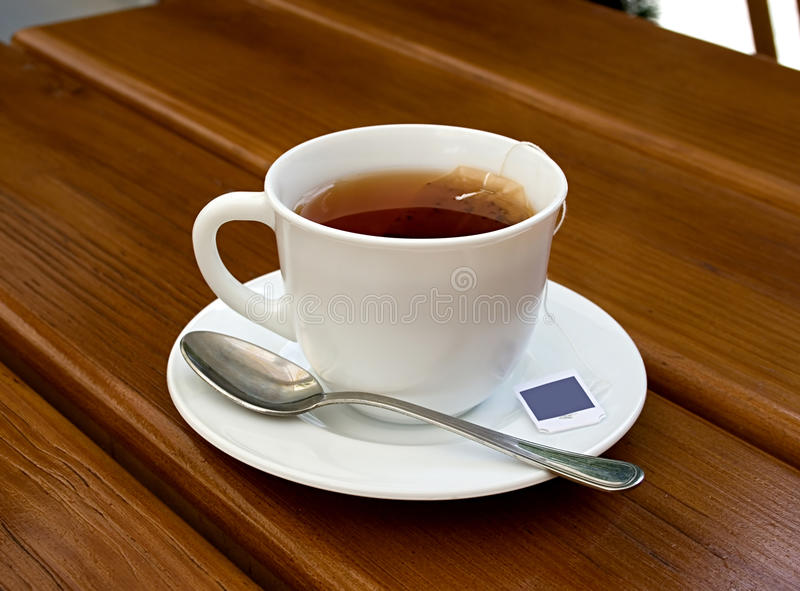 Tea, cup, spoon, wood, table stock image