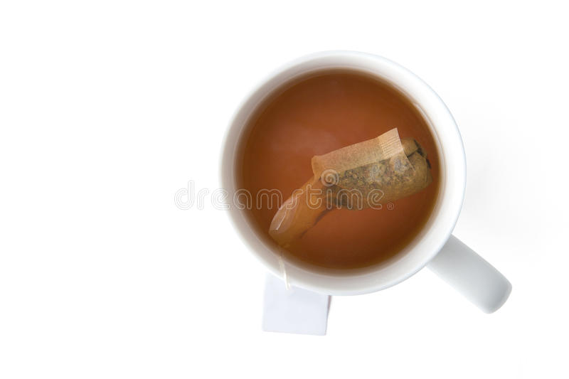 Tea cup with tea bag royalty free stock image