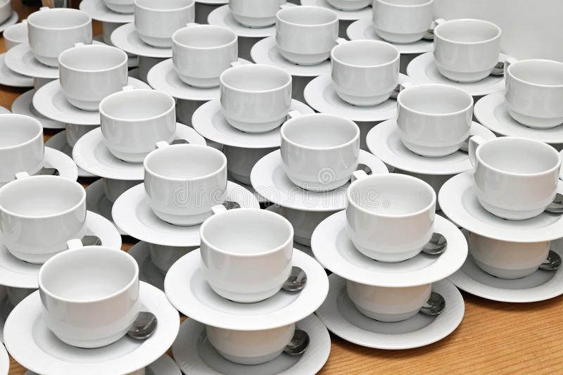 Tea cups. Big bunch of plain white tea cups royalty free stock photography