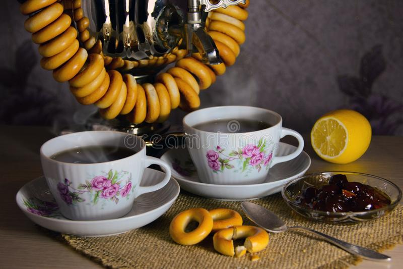 Tea drinking. With jam, bagels & lemon royalty free stock photos