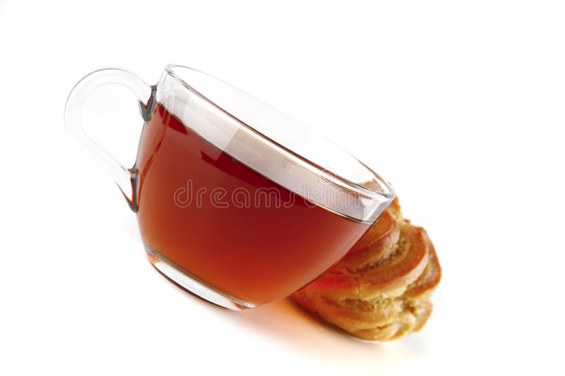 Tea and eclair on white. Background close up stock photo