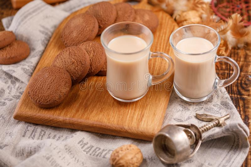 Tea is in English. Delicious and healthy breakfast. Tea with milk and oatmeal cookies. stock photos