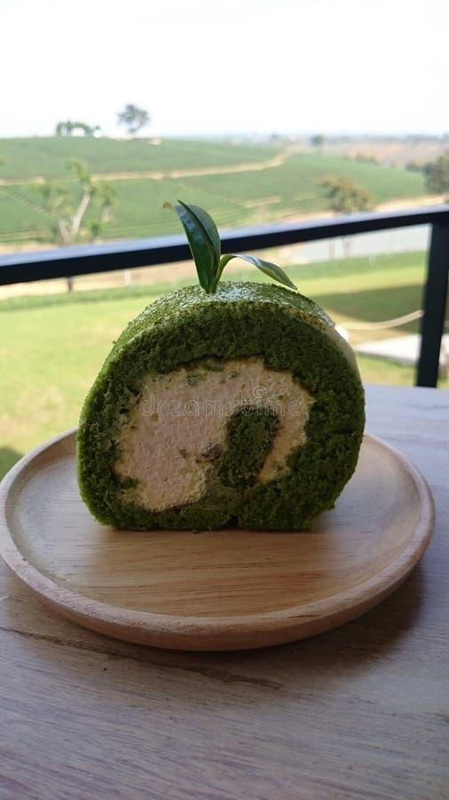 tea för cakegreenrulle royaltyfri foto