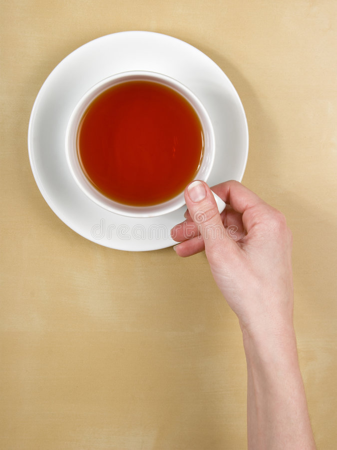 Download Tea - Female Hand Holds A Cup Of Tea On Wood Table Stock Photo - Image: 8263020